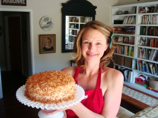 This is probably my favorite cake in the whole world - coconut cake - and I swear I *am* wearing clothes under my apron. Ah, the hazards of a strapless dress.